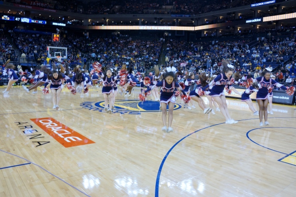 Dublin High School Cheer Team in flight at the Warriors Half Time Show