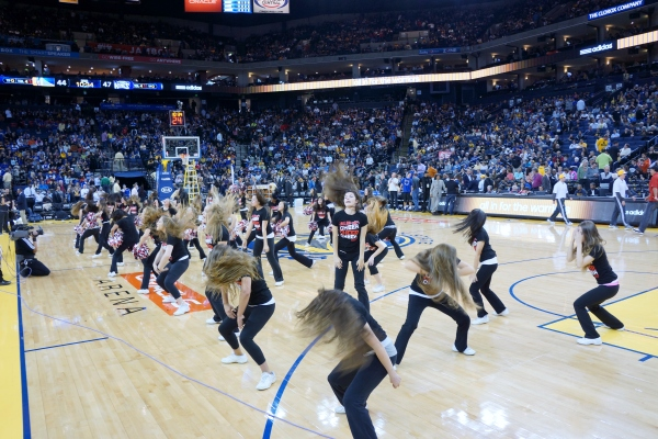 Fallon Middle School Cheer Team in the Warriors Half Time Show