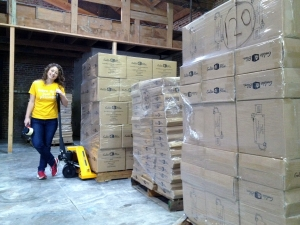 GoldieBlox Founder Debbie Sterling with the First Shipment of GoldieBlox Toys