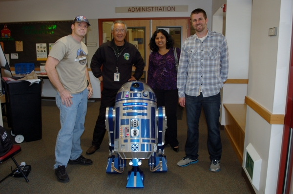 John Green Elementary School Principal Keith Nomura with Star Wars Robot and Science Fair Organizers