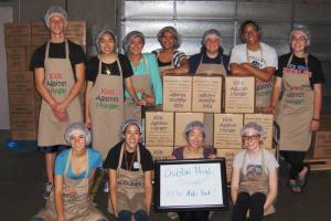 Kids Against Hunger packing event