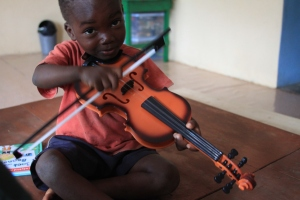 Happy Kids child playing a violin