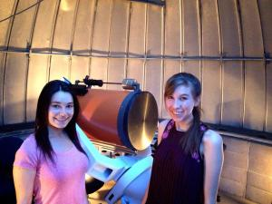 Ariel Graykowski (right) with friend by a telescope at observatory