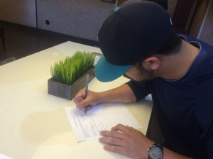 Joe signing the contract