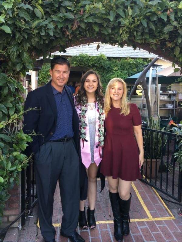 Katelyn Haubert graduating Chapman University - with her parents