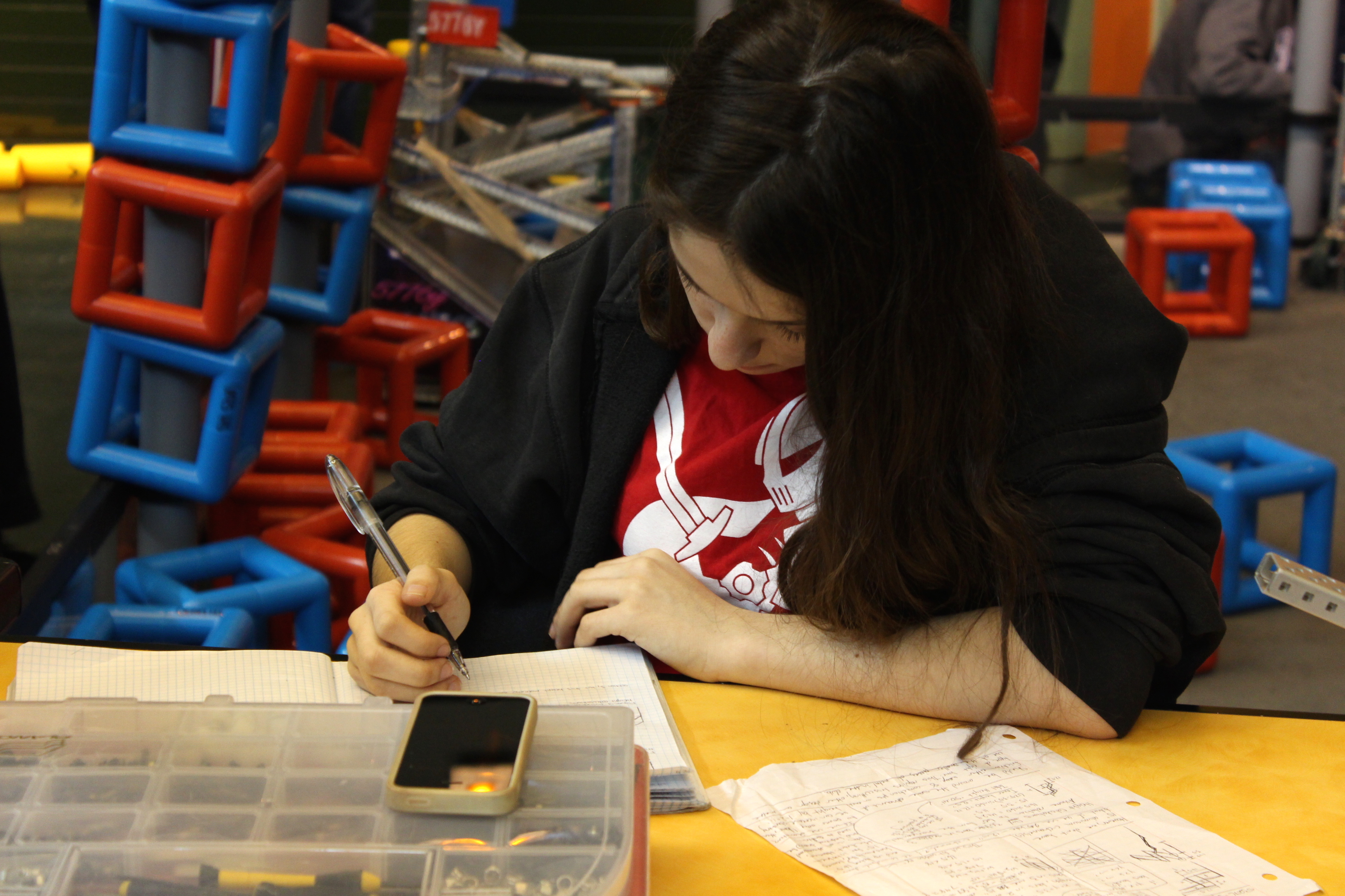 Working On The Engineering Notebook At A Vex Robotics Competition