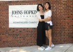 photo with mom in front of the jhu campus